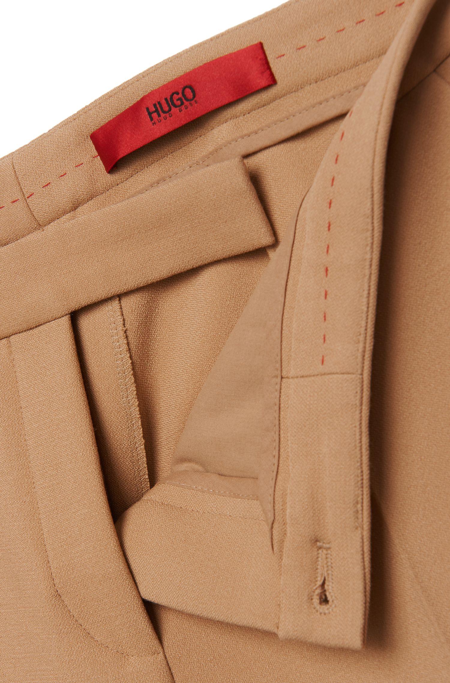 Pantalon taille basse en mélange de matières extensible: «Hokena»