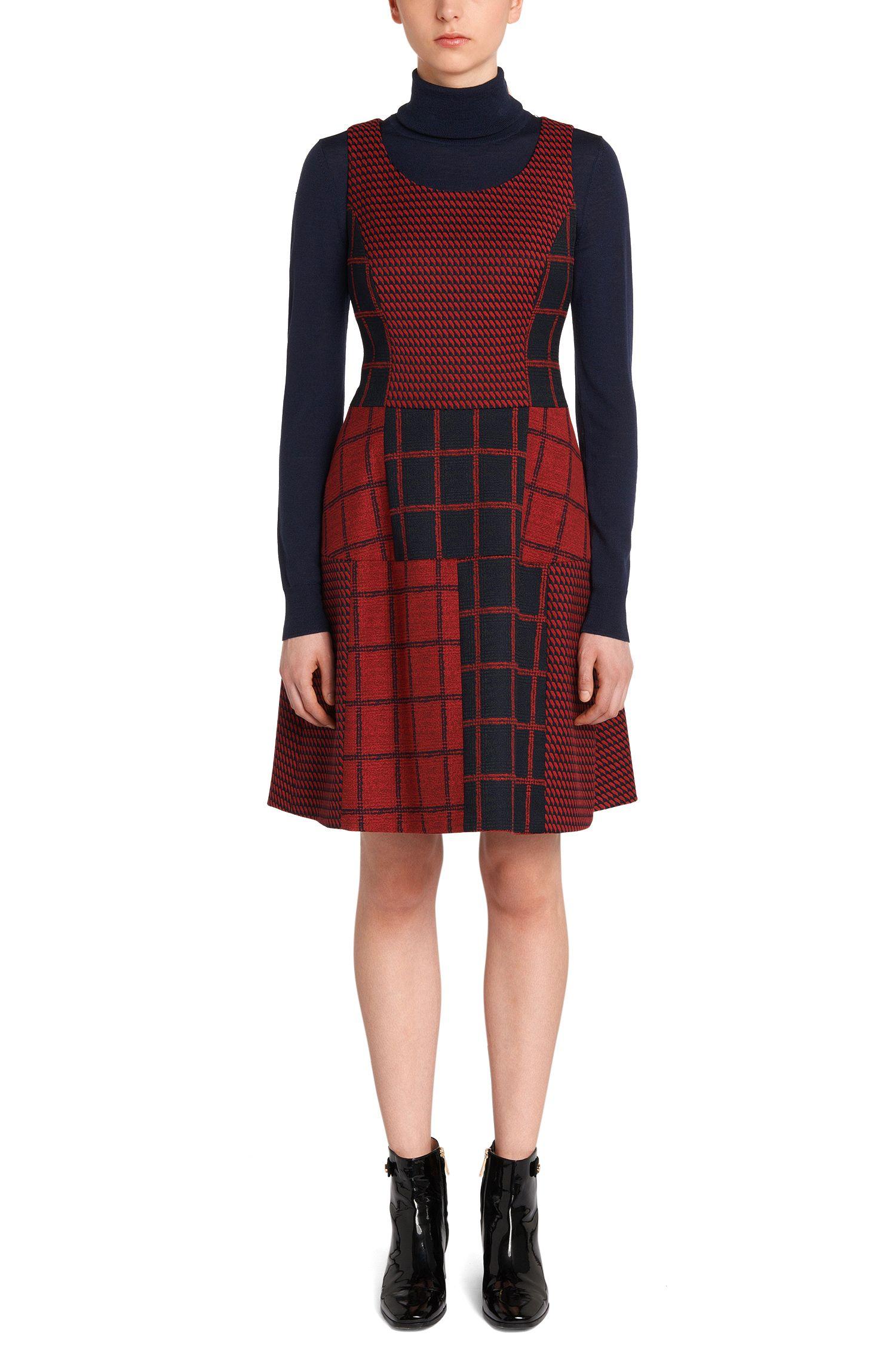 Mouwloze jurk in een motiefmix: 'Kine'