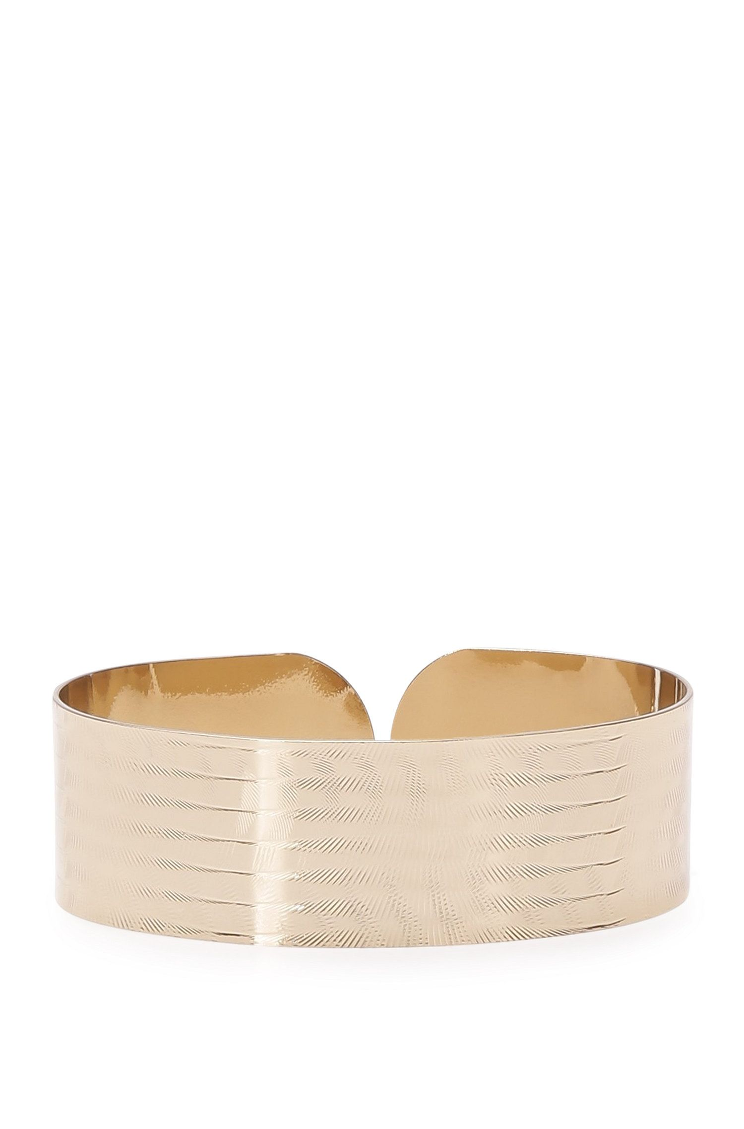 Brass bangle with engraving: 'Myrina'