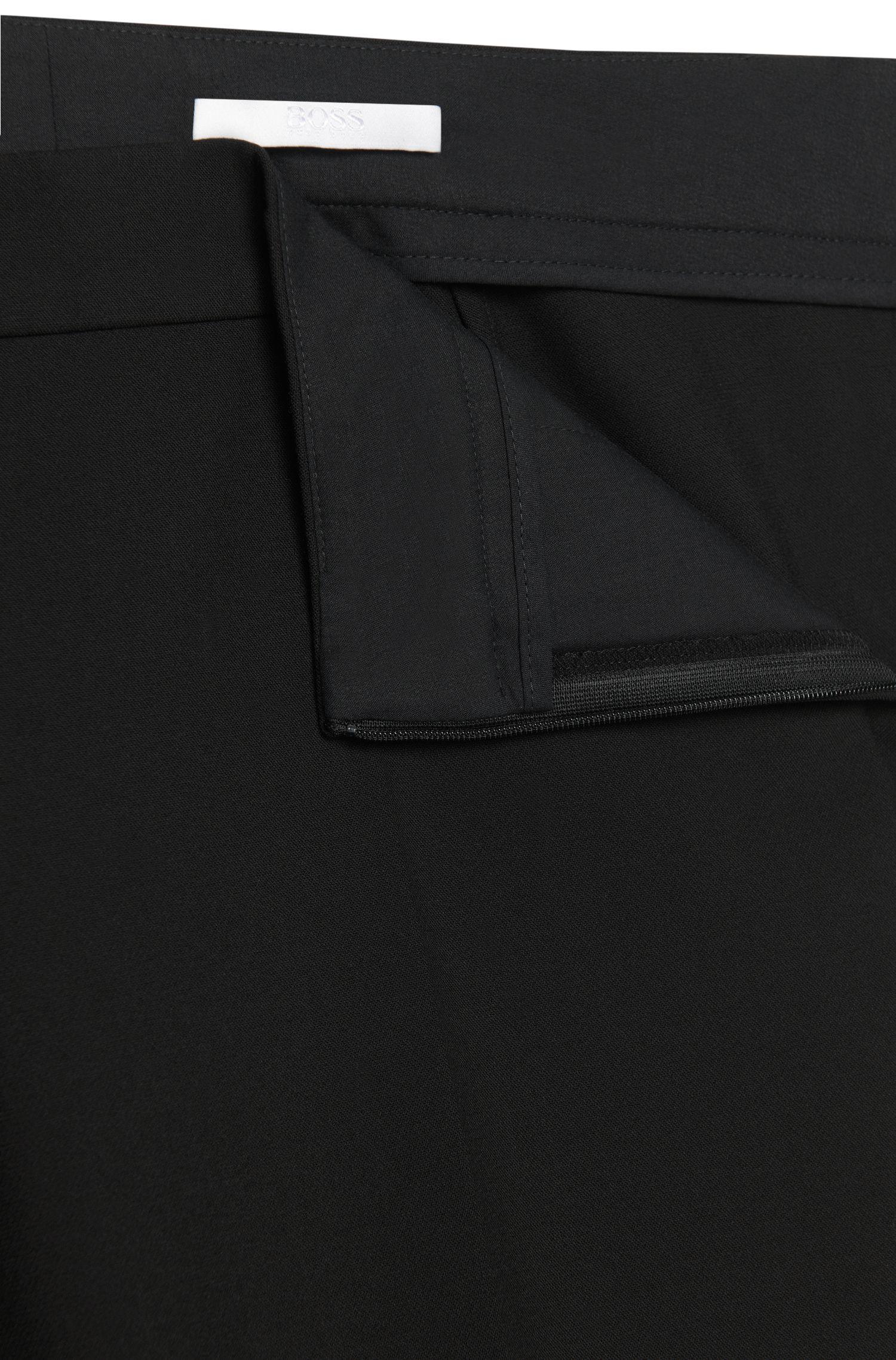 Slim-fit broek met uitlopende pijpen: 'Tutina1'