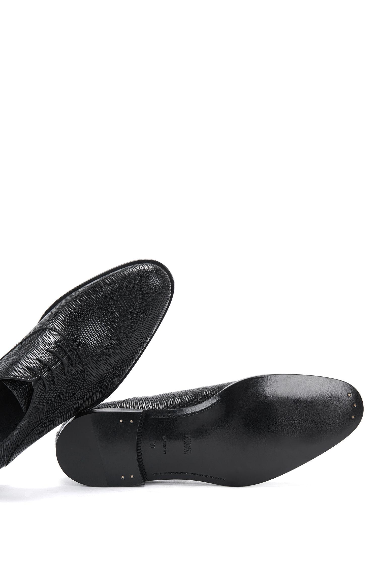 Schnürschuhe aus Leder mit Allover-Prägung 'Sigma_Oxfr_exo'