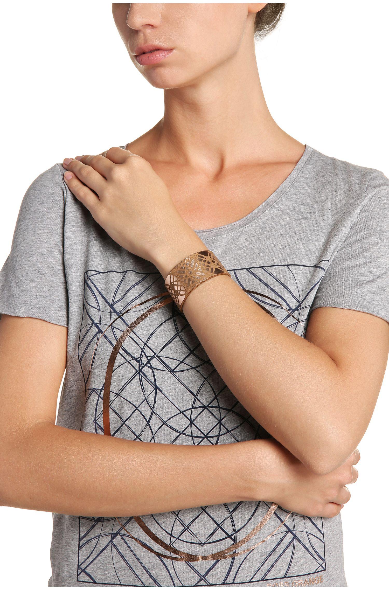 Brede leren armband met een grafisch patroon: 'Mircle'