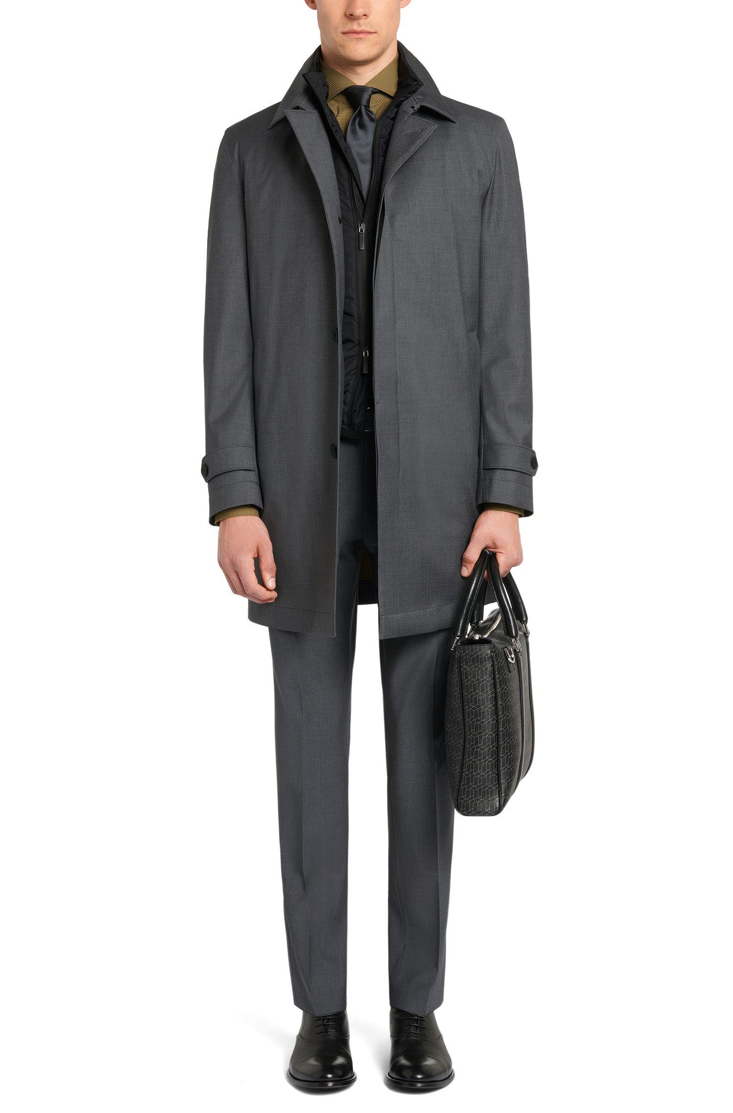 Waterafstotende mantel van een scheerwolmix met uitneembaar binnenstuk: 'Gadget'