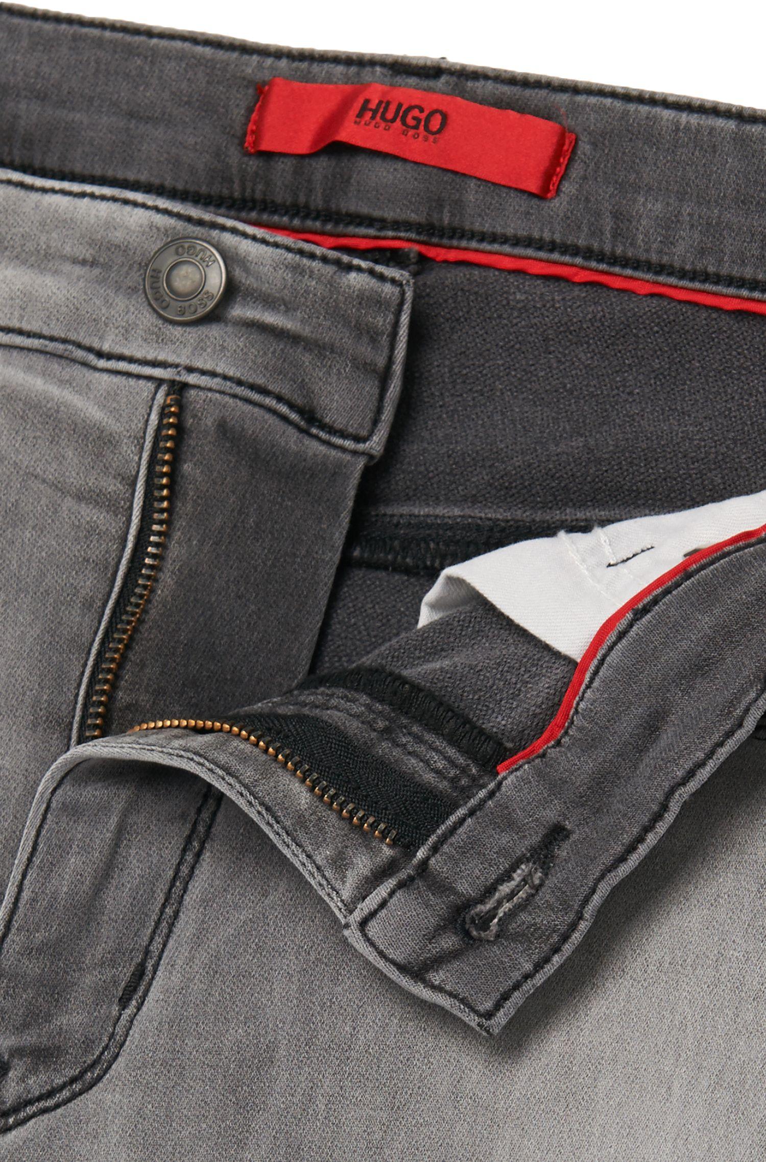 Slim-fit jeans van een stretchkatoenmix met used wassing: 'HUGO 708'