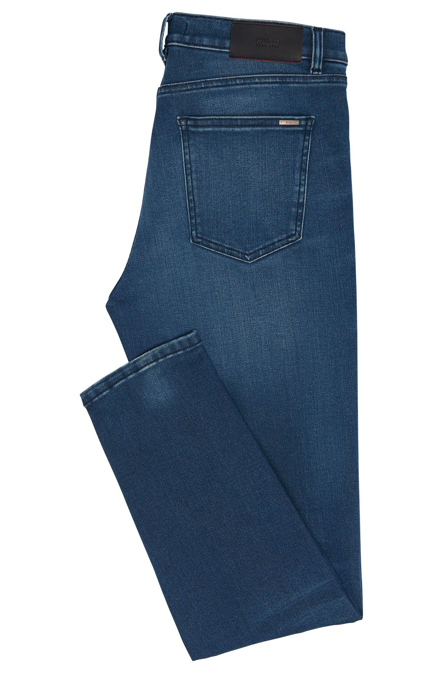 Jeans Slim Fit en coton mélangé extensible au délavage usé: «HUGO 332»