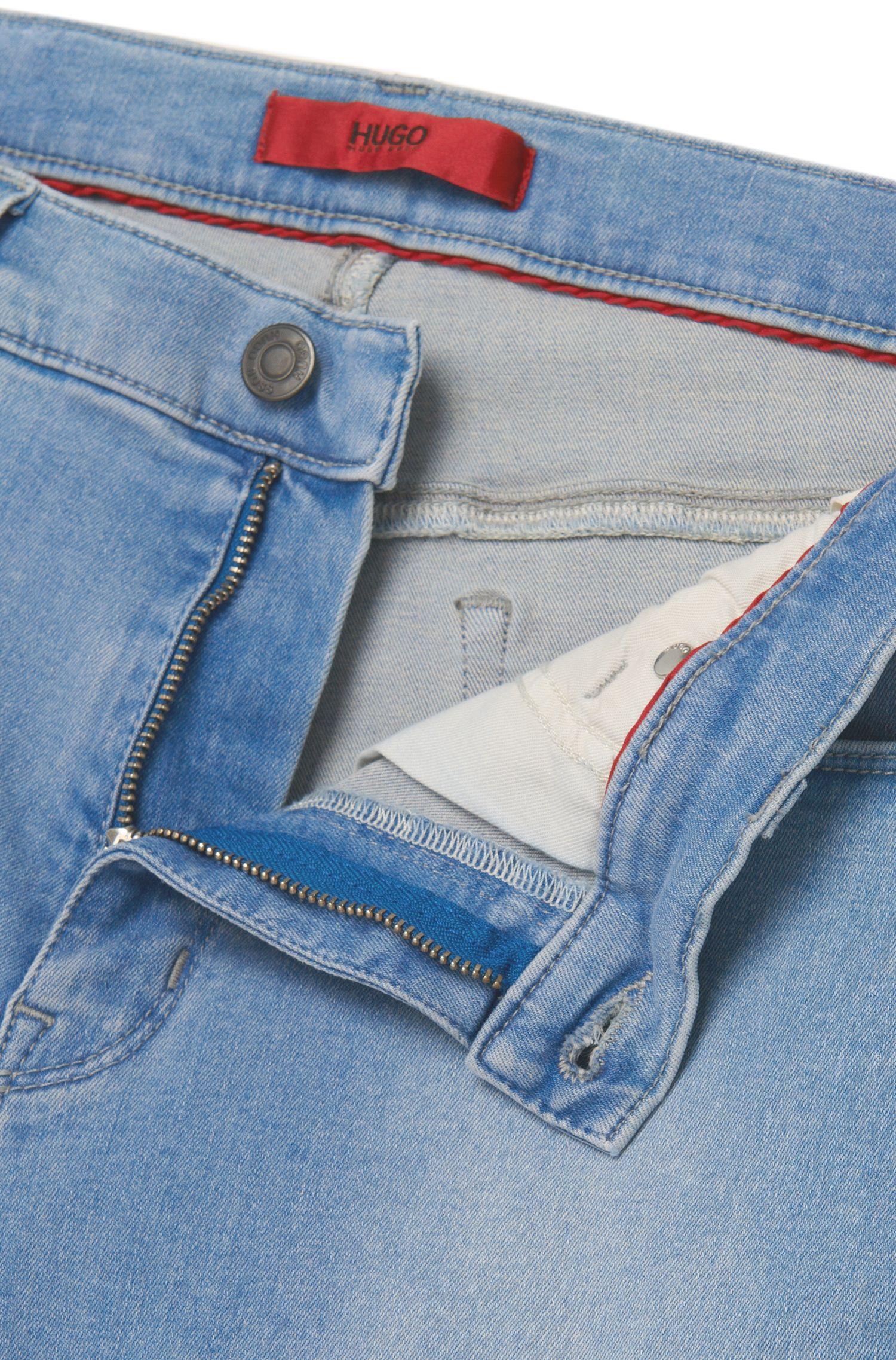 Slim-Fit Jeans aus elastischem Baumwoll-Mix mit Used-Waschung: 'HUGO 708'