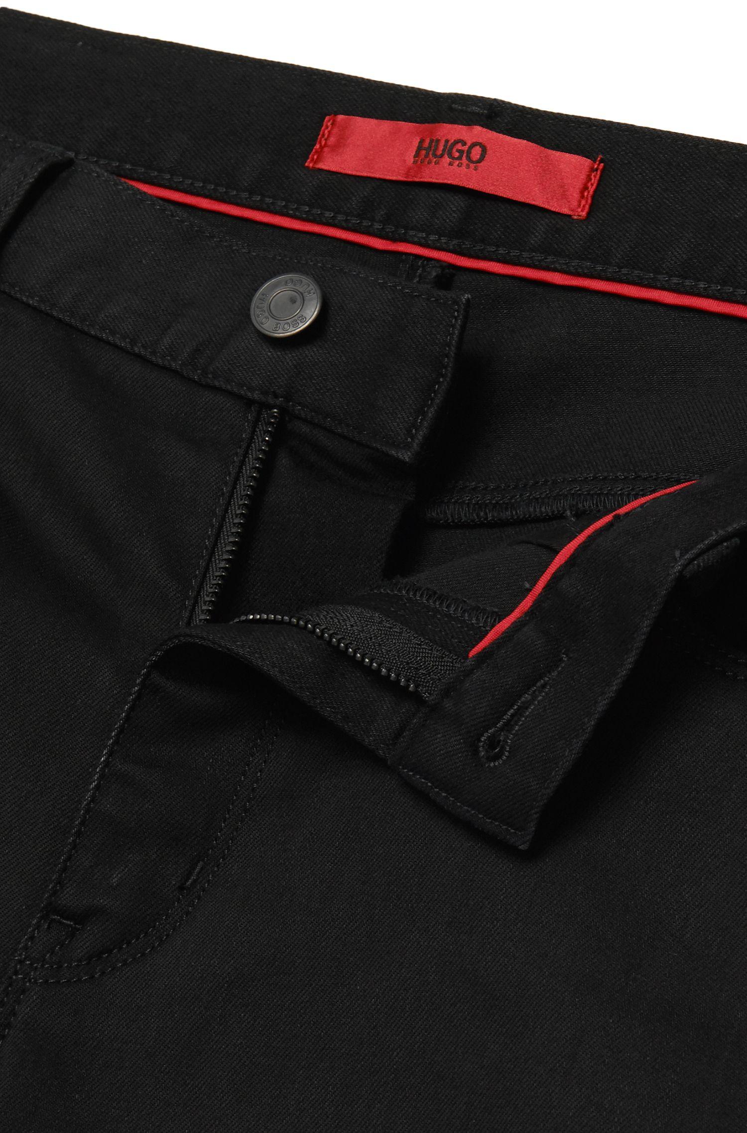 Dezent schimmernde Slim-Fit Jeans aus Baumwoll-Mix mit Viskose: 'HUGO 708'