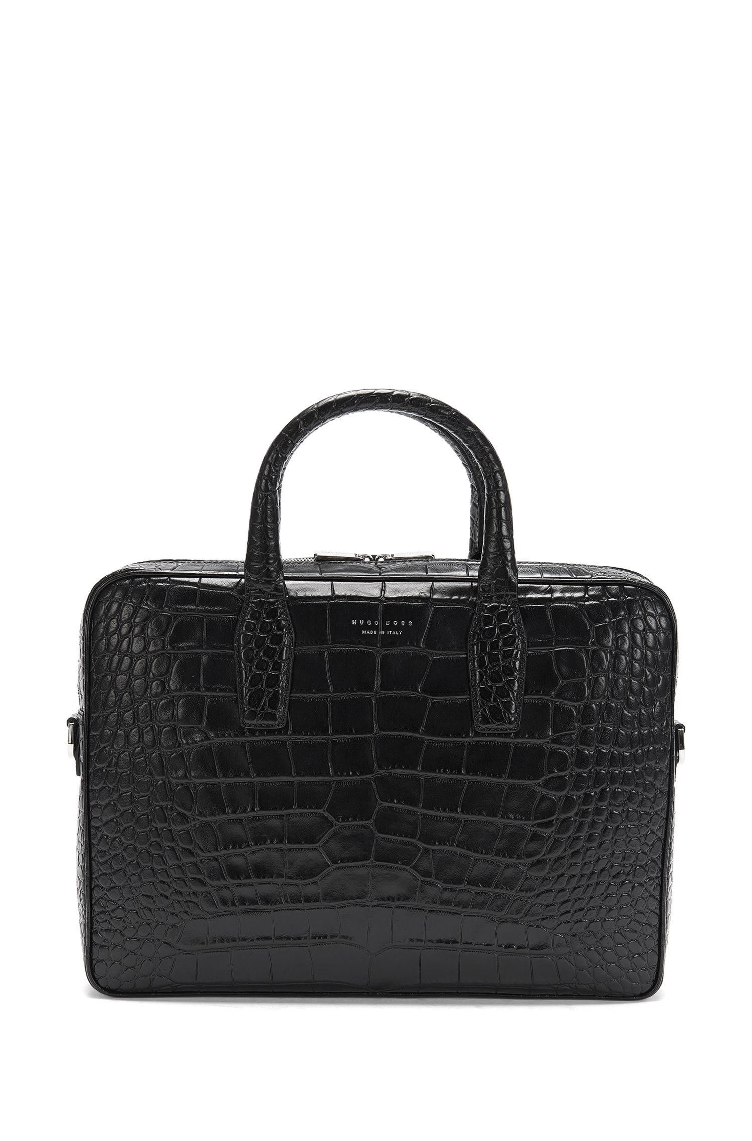 Embossed leather bag with shoulder strap: 'Elite C_S doc'