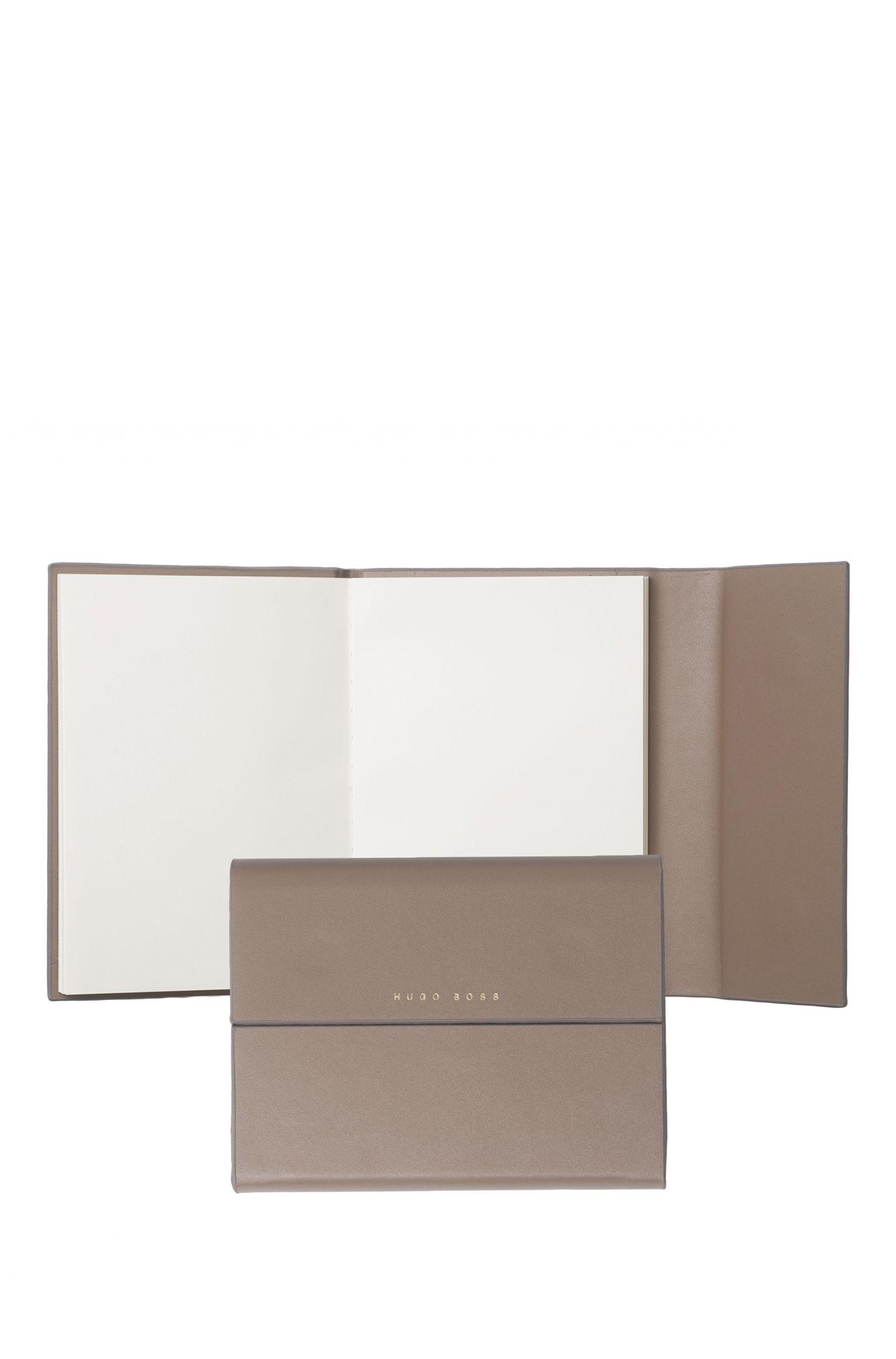 A6-notitieboekje met insteekvak: 'Verse'