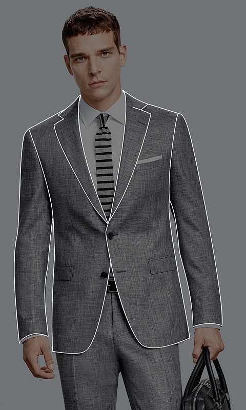 Male Model wearing a regular fit suit in dark blue and whiteshirt