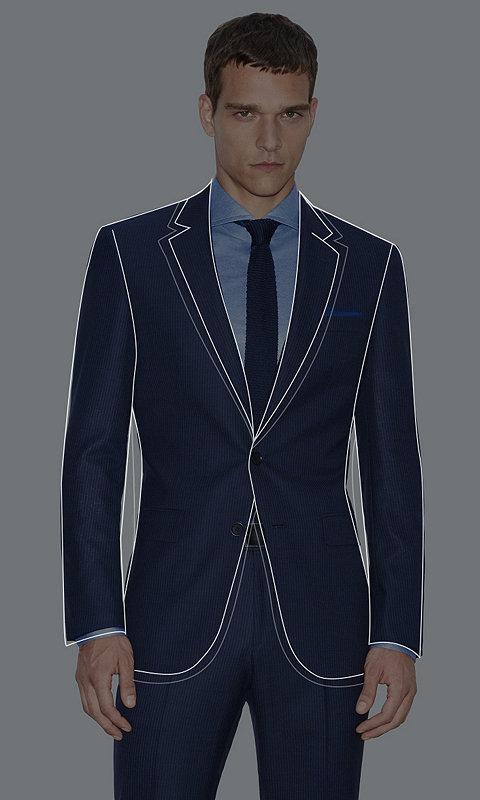Male Model wearing a dark pinstriped slim fit suit ingrey