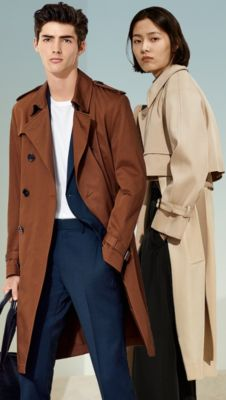 Couple wearing trench coats from BOSS
