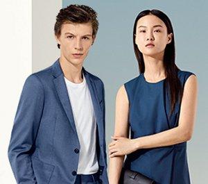 Male model wearing white t-shirt and dark blue blazer, female mode wearing sleeveless ...