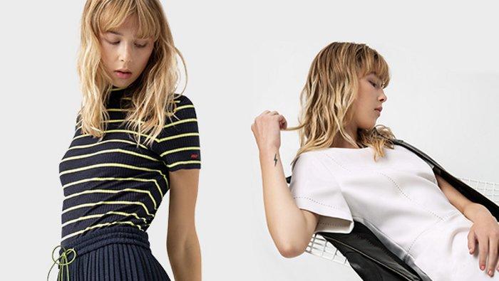 Een vrouwelijk model draagt twee lentestijlen van HUGO