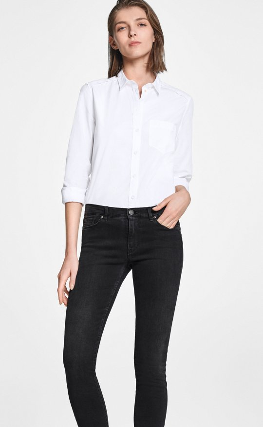 5e74957f694 Woman is wearing skinny fit jeans from BOSS ...