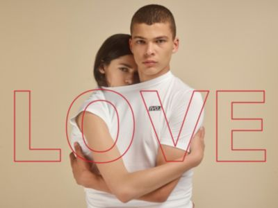 Female and male models wearing a white t-shirt with personalisation from HUGO