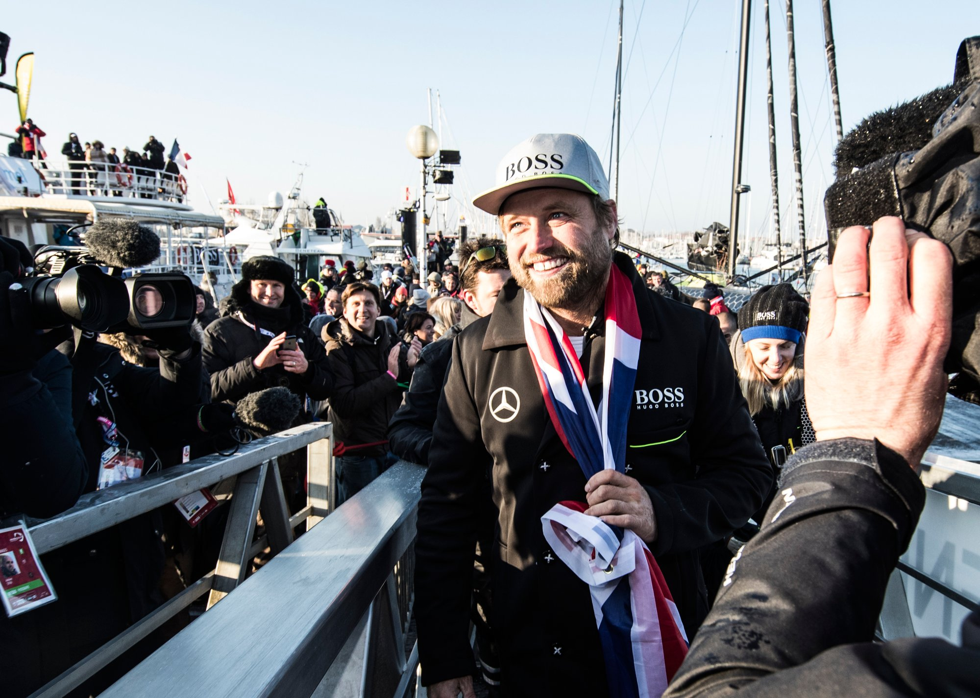 Alex Thomson leaving the HUGO BOSS yacht