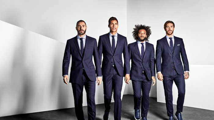 Team of Real Madrid dressed in a dark blue suit by BOSS.