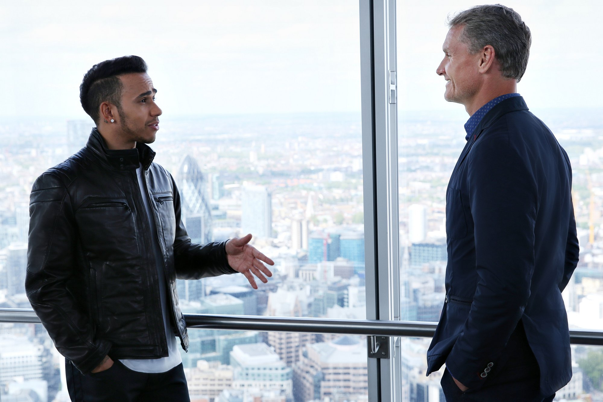 Lewis Hamilton wearing a black leather jacket by BOSS, David Coulthard wearing a dark blue suit by BOSS