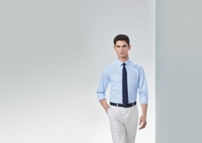 Shirt with sleeves rolled up and blue tie by BOSS