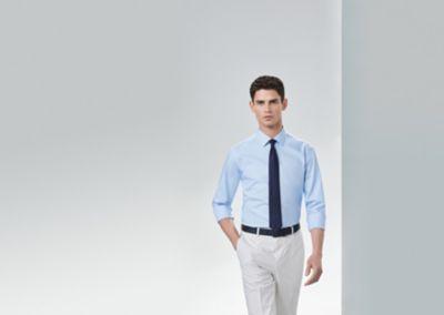 Comment retrousser vos manches de chemise