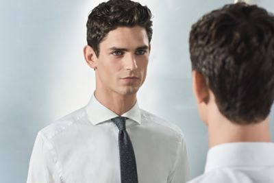Man adapting the tie knot by BOSS