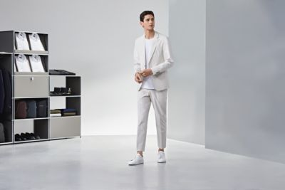 Man is wearing a white summer suit from BOSS