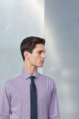 Male model is wearing a shirt and tie from BOSS