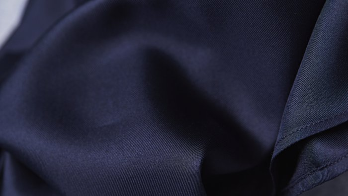 Dark blue silk fabric close up by BOSS
