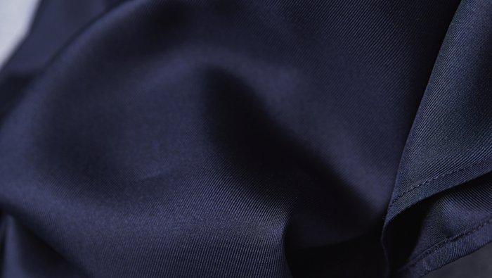 Dark blue silk fabric close up by BOSS