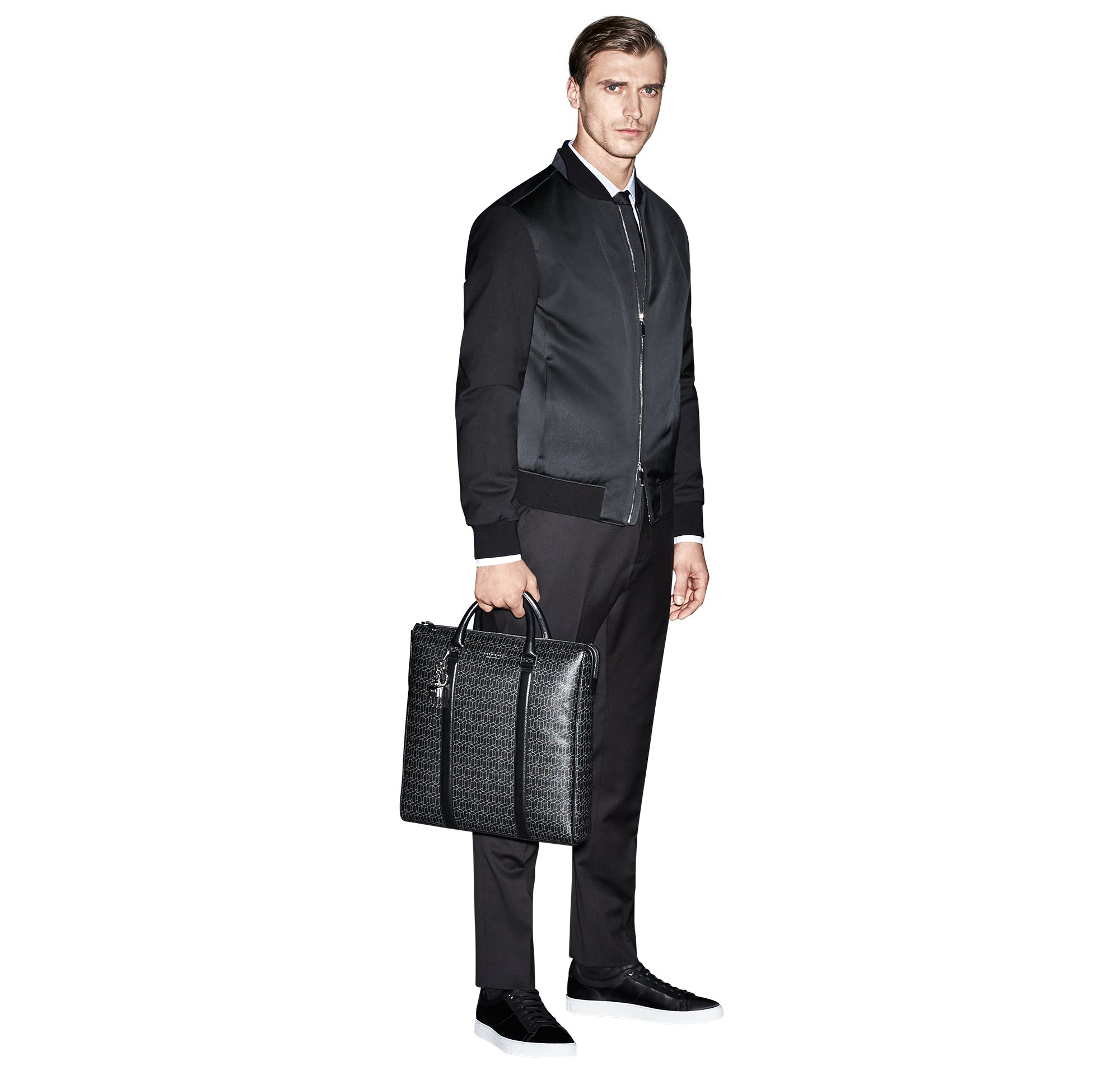 Black bomber jacket and trousers, white shirt and black tie by BOSS