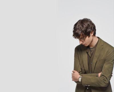 Male model wearing a garment dyed suit by BOSS
