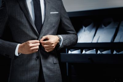 Man is wearing a suit by BOSS