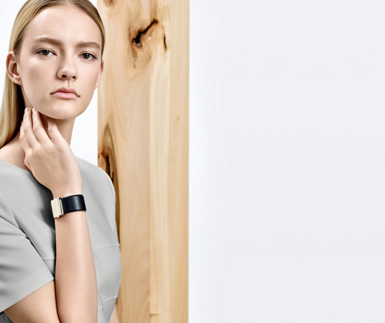 Model with black HUGO BOSS leather bracelet. Smooth leather combined with a nobel metal clasp.