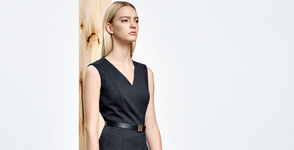 Model with elegant HUGO BOSS leather belt. Polished metal hardware. Combined with a darkgrey dress.