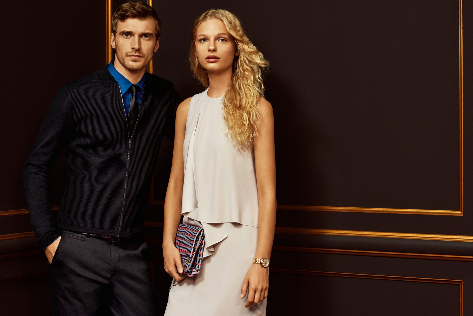 Couple wearing knitwear and dress by BOSS