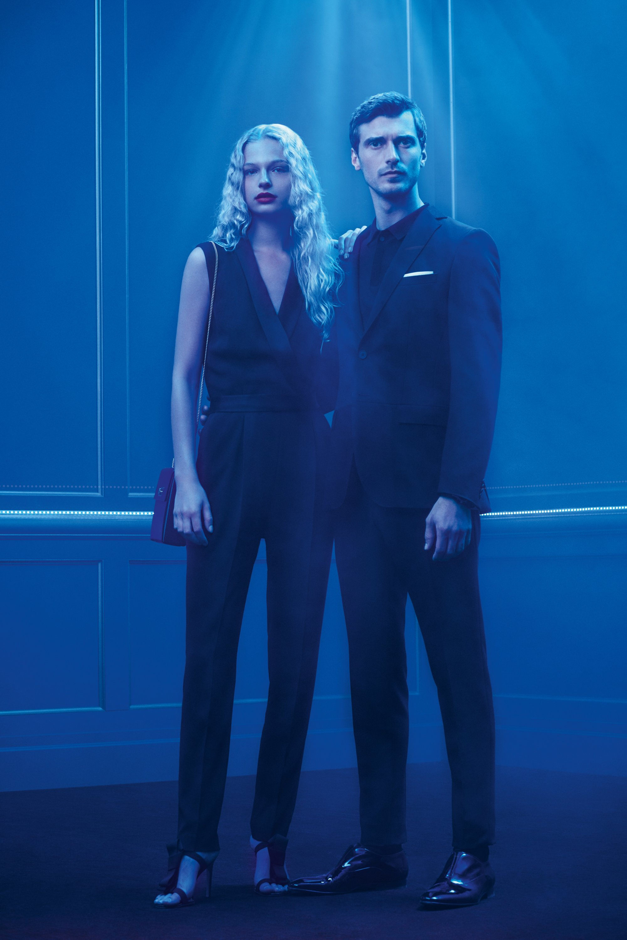 Couple wearing a jumpsuit and suit by BOSS