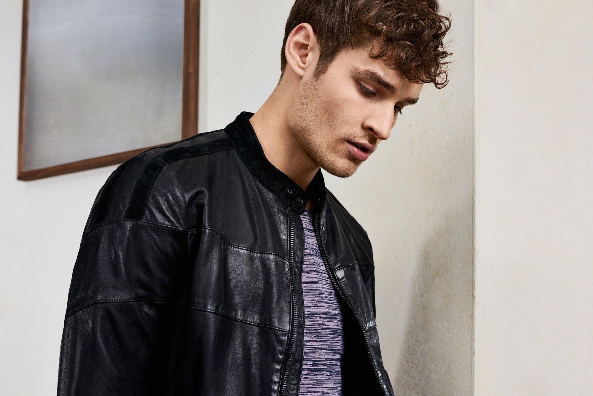 Man in black leather jacket by BOSS Orange