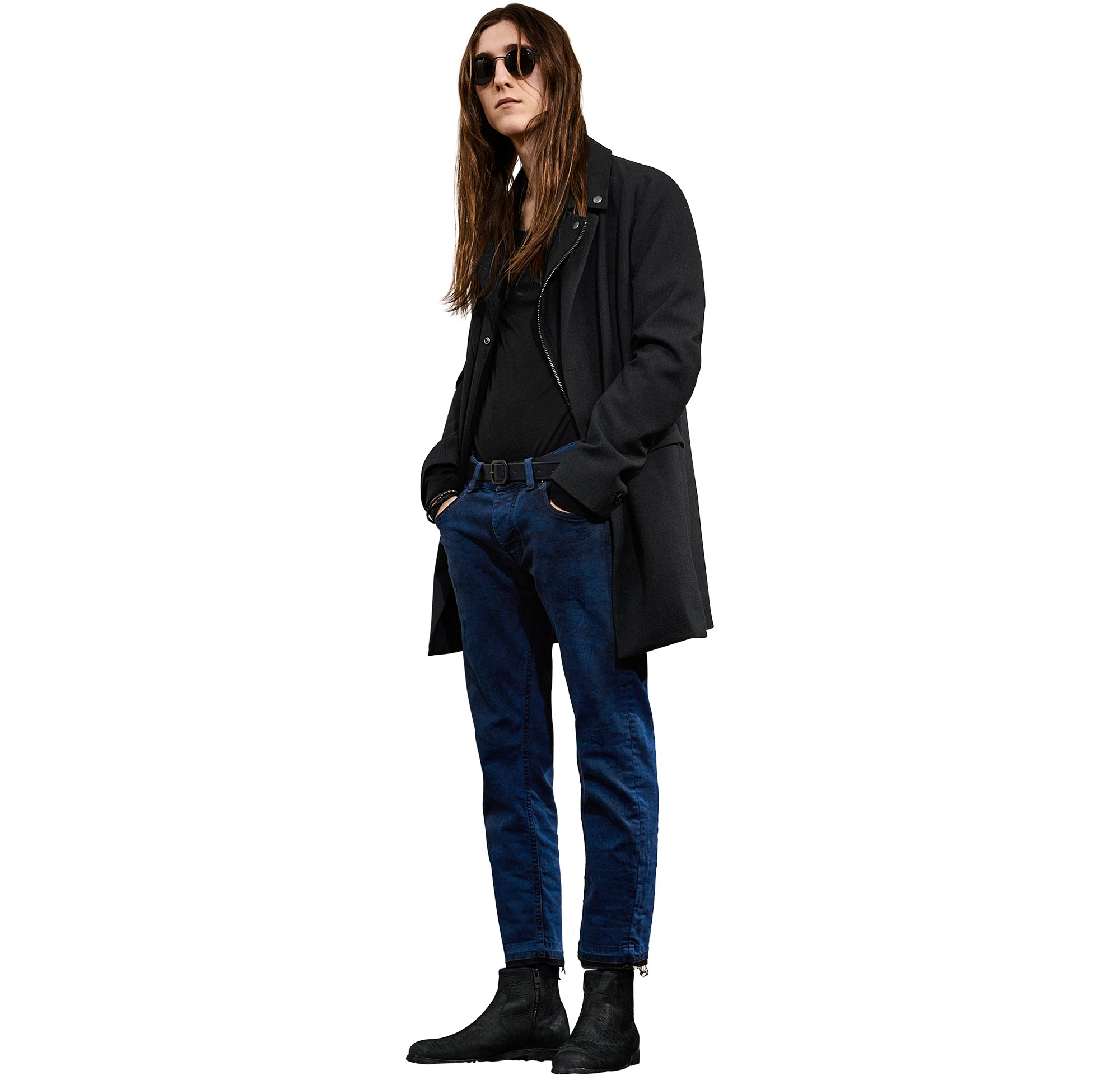 Black jacket over black jersey and blue jeans with black shoes by BOSS Orange