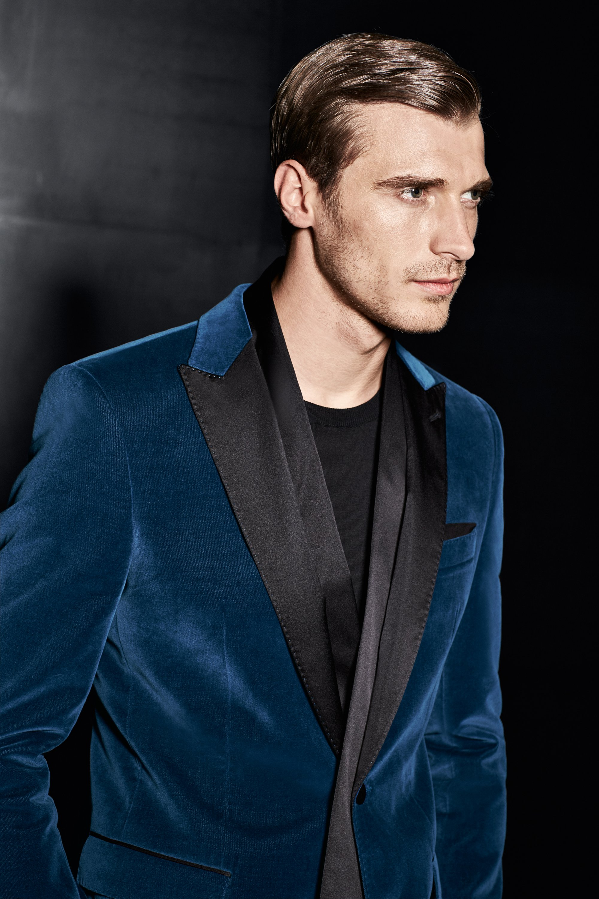 Blue jacket over black knitwear by BOSS