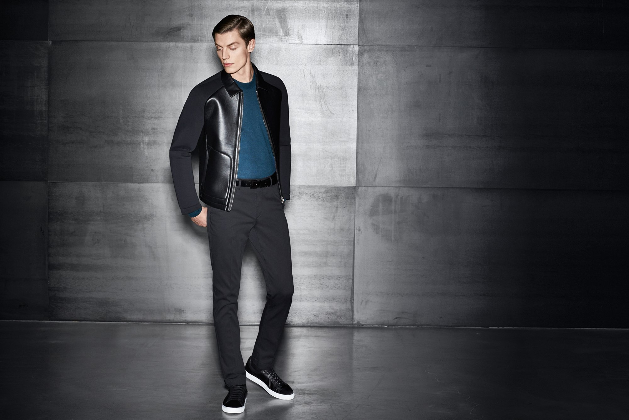 Leather jacket, blue knitwear and black trousers by BOSS