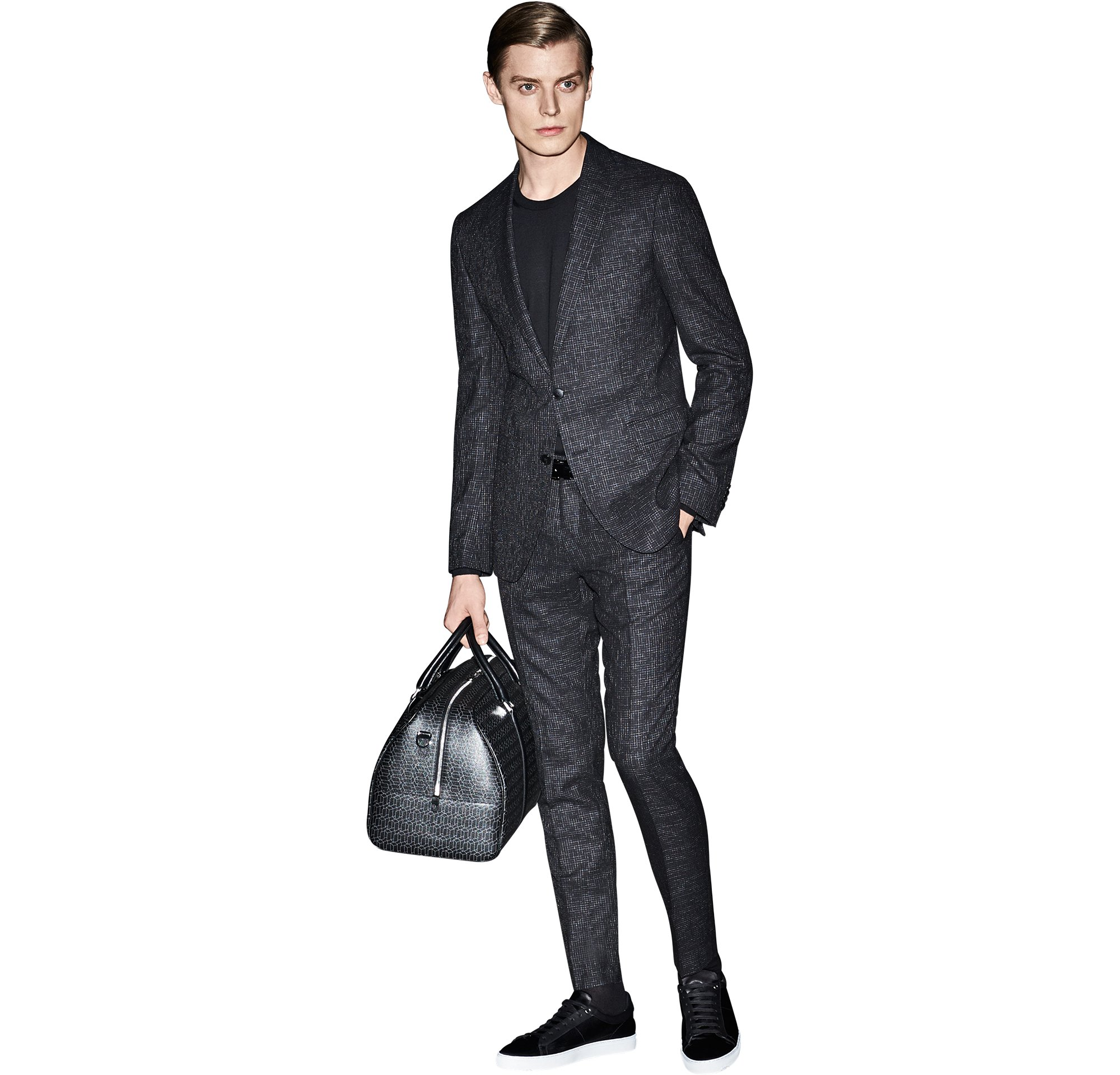 Black suit over black knitwear with a black leather bag and black shoes by BOSS