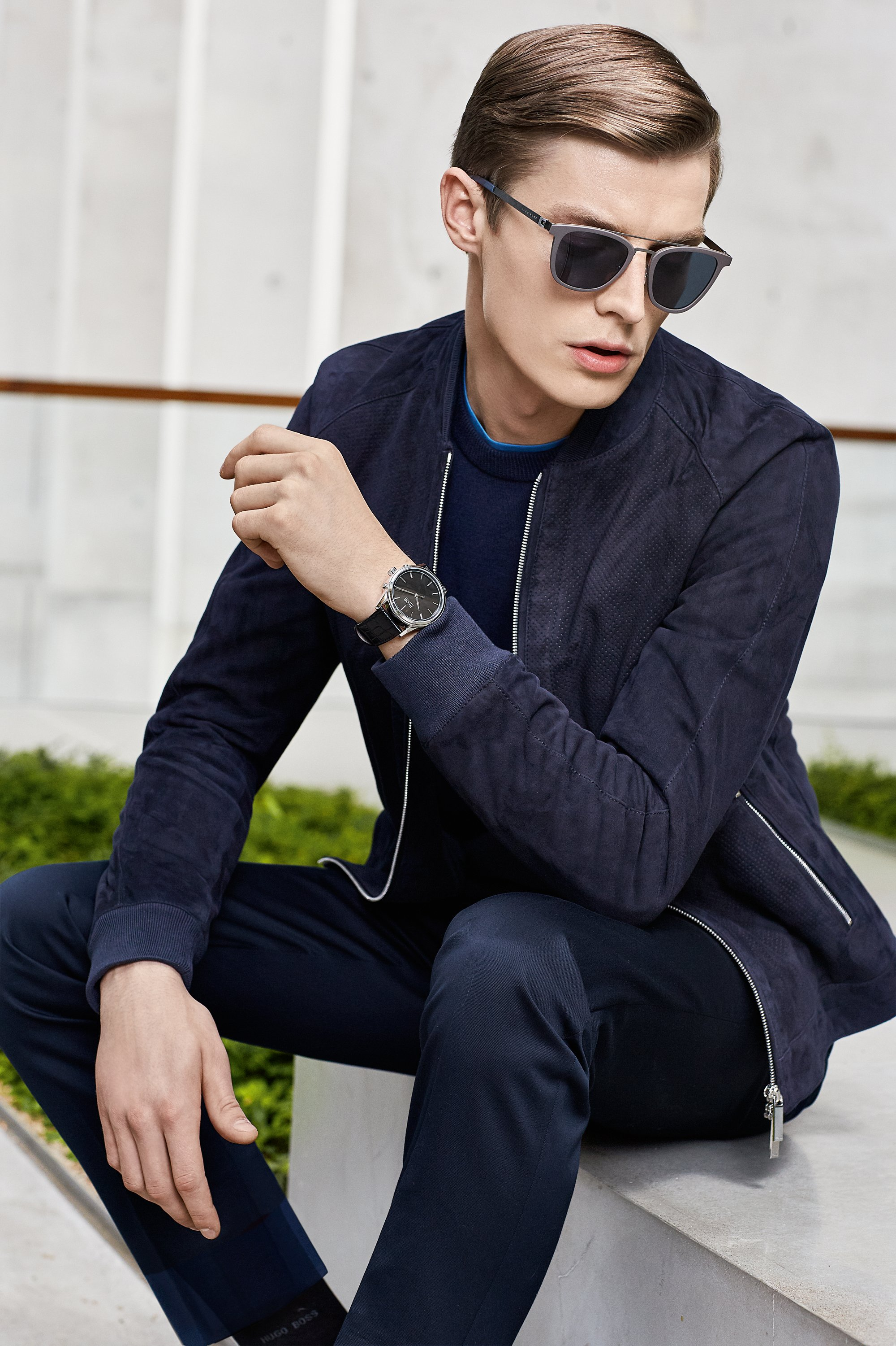 Dark blue leather jacket, jersey and trousers paired with glasses and a watch by BOSS