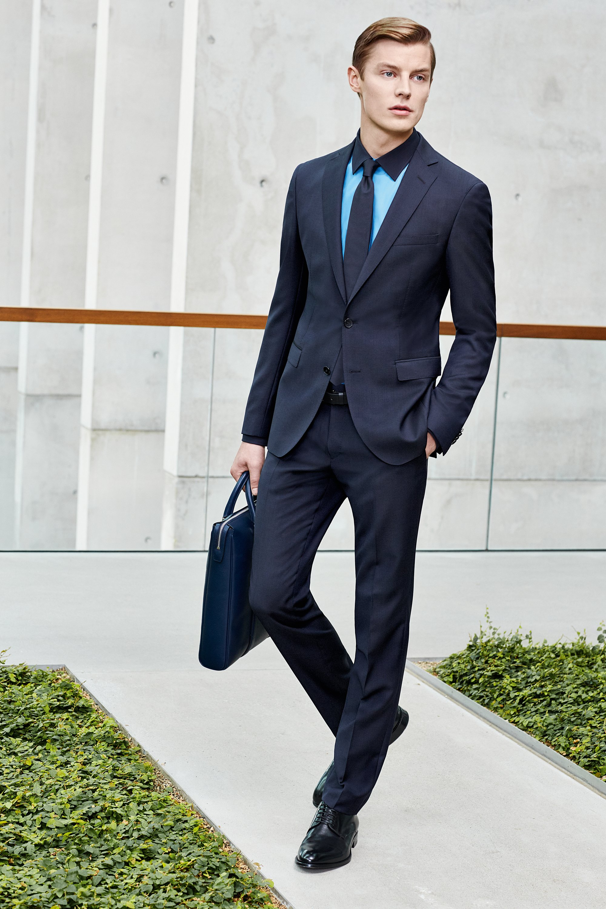 Blue suit, shirt, neckwear, belt, shoes and signature tote bag by BOSS