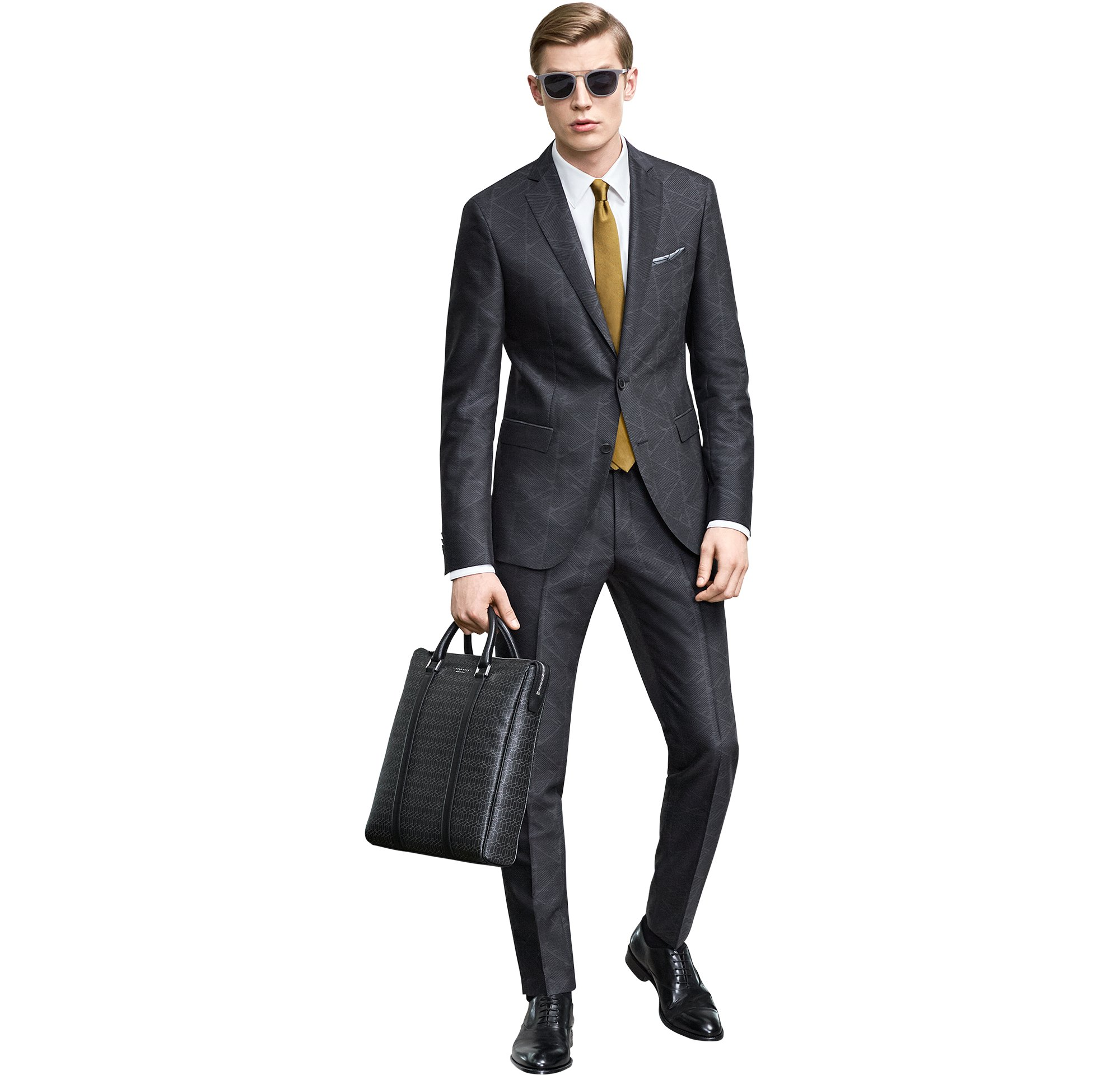 Dark grey suit over white shirt and tie with leather bag by BOSS