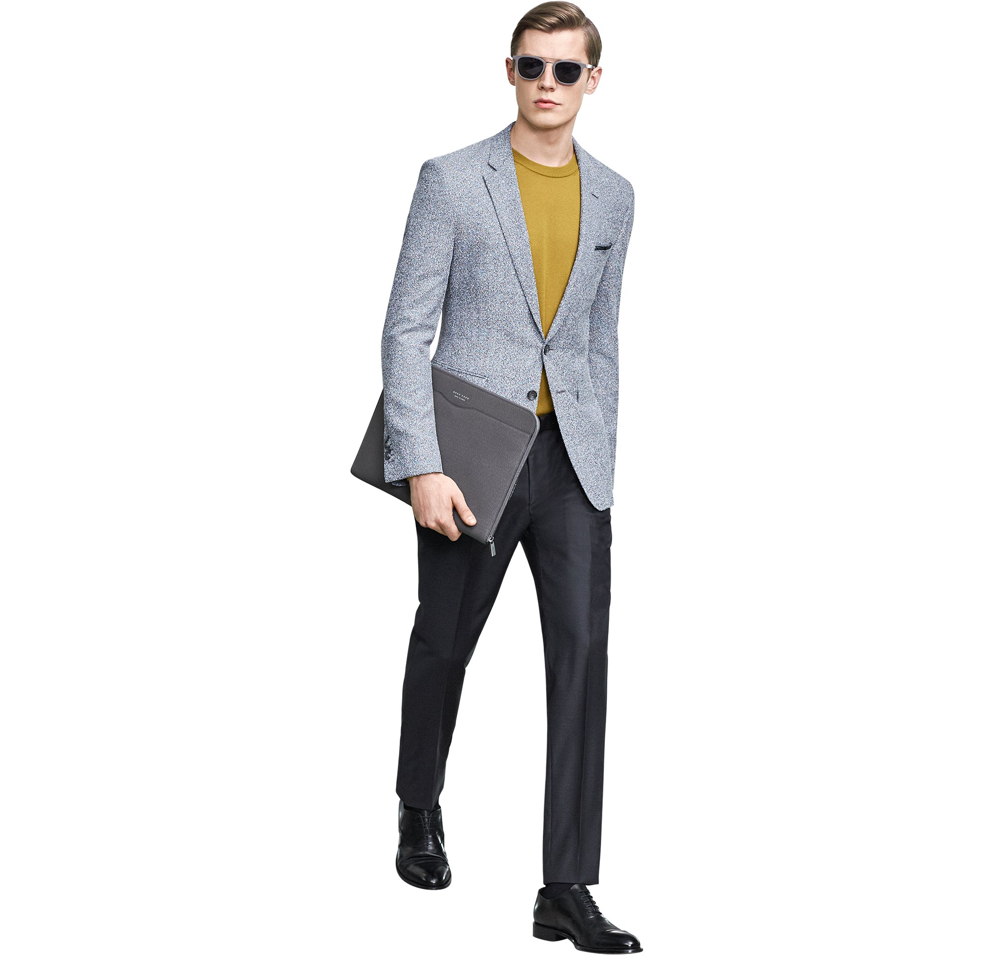 Grey jacket over yellow knitwear and black trousers with bag and shoes by BOSS