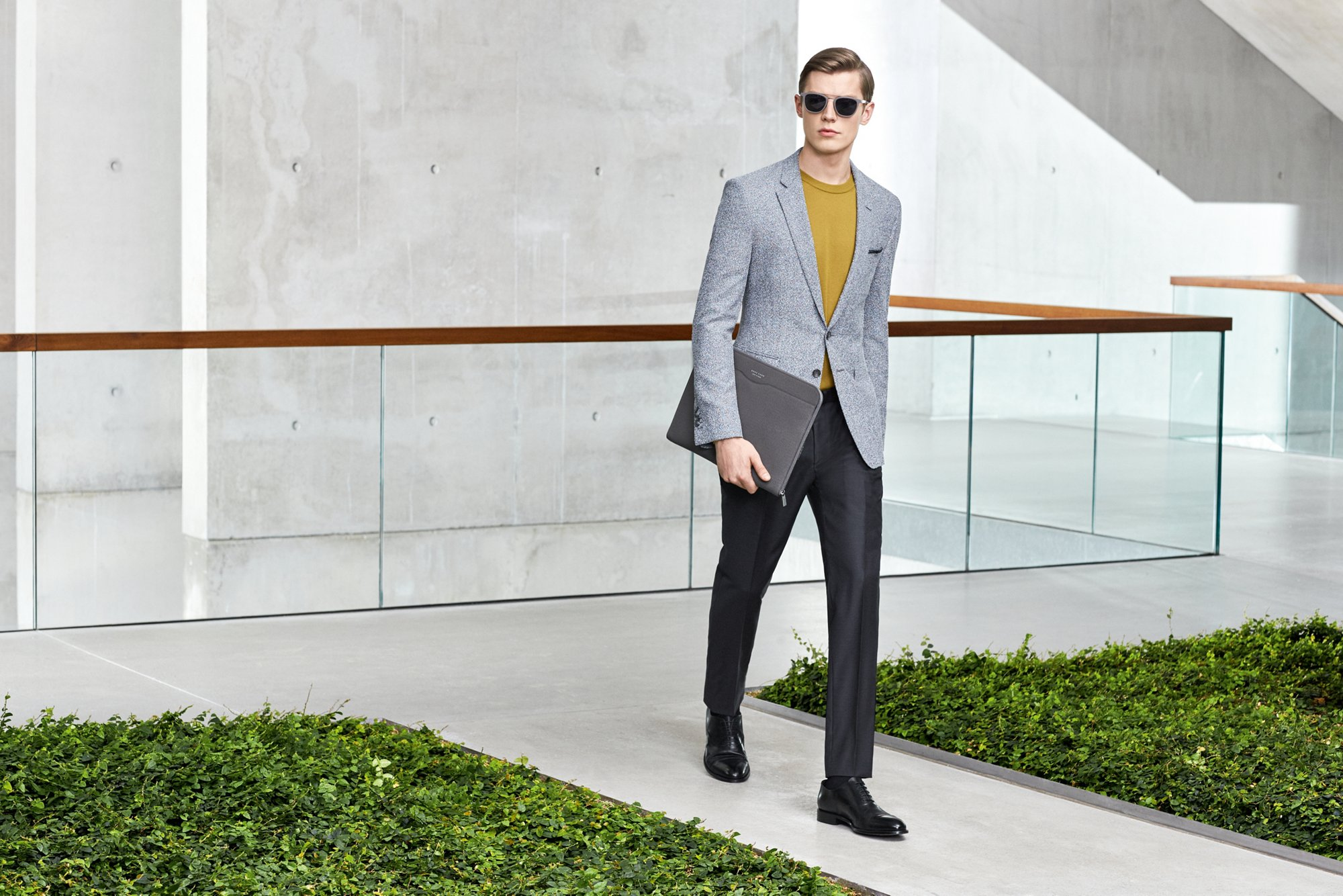 Yellow coat over grey suit and white shirt with black shoes by BOSS