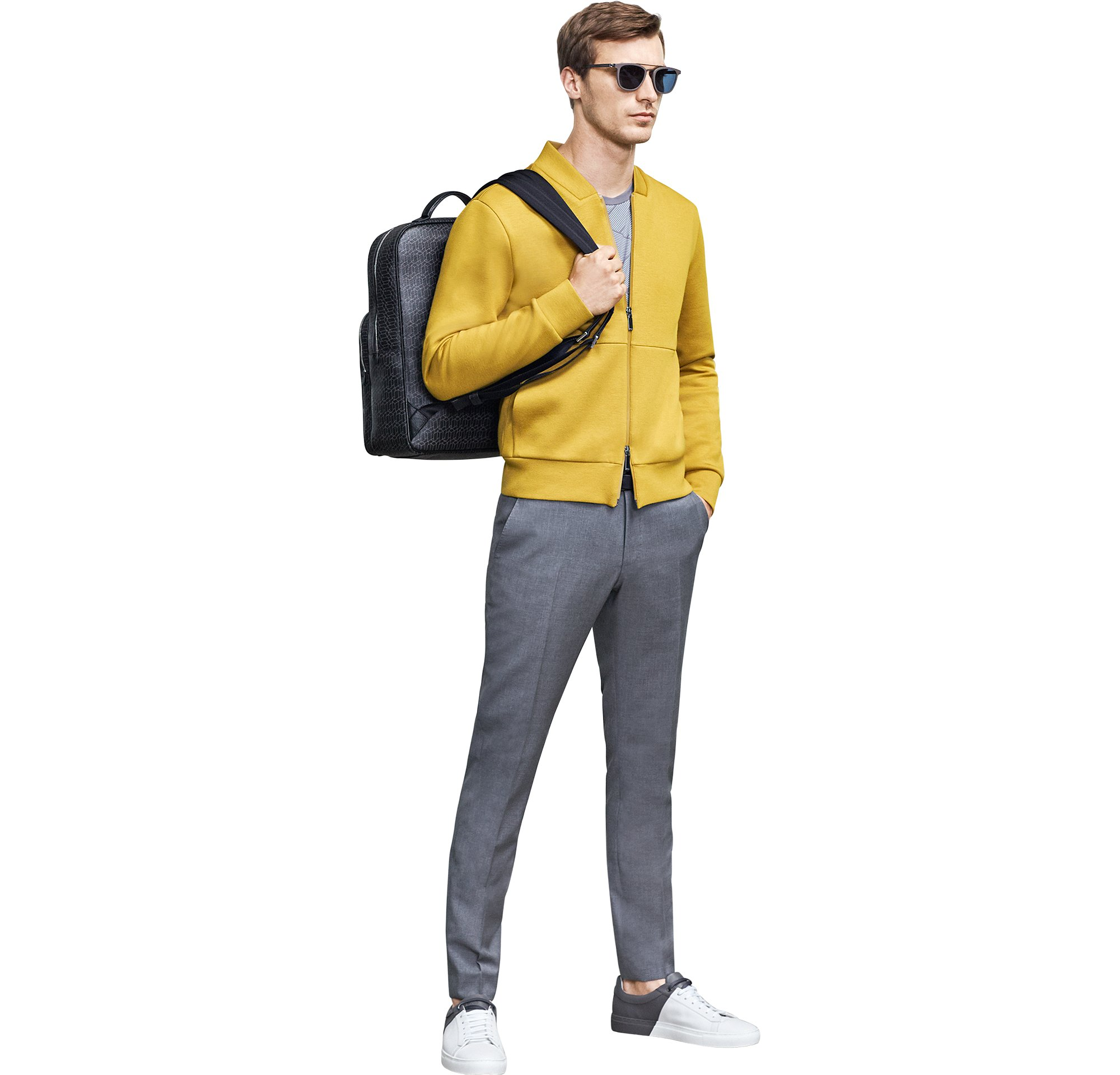 Yellow jersey over grey jersey and grey trousers with backpack and sneakers by BOSS