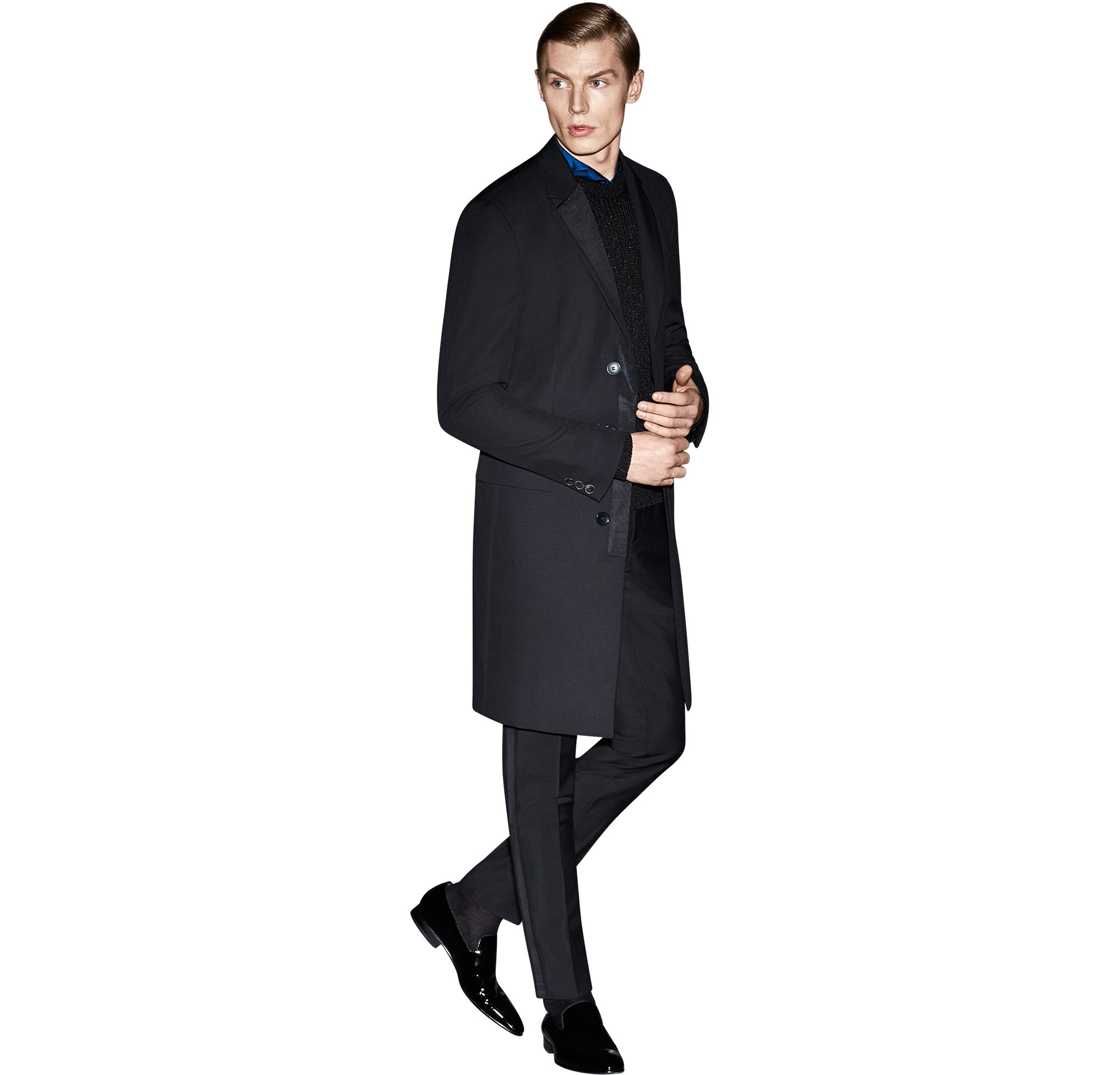 Black coat over black knitwear and blue shirt with black trousers and black shoes by BOSS