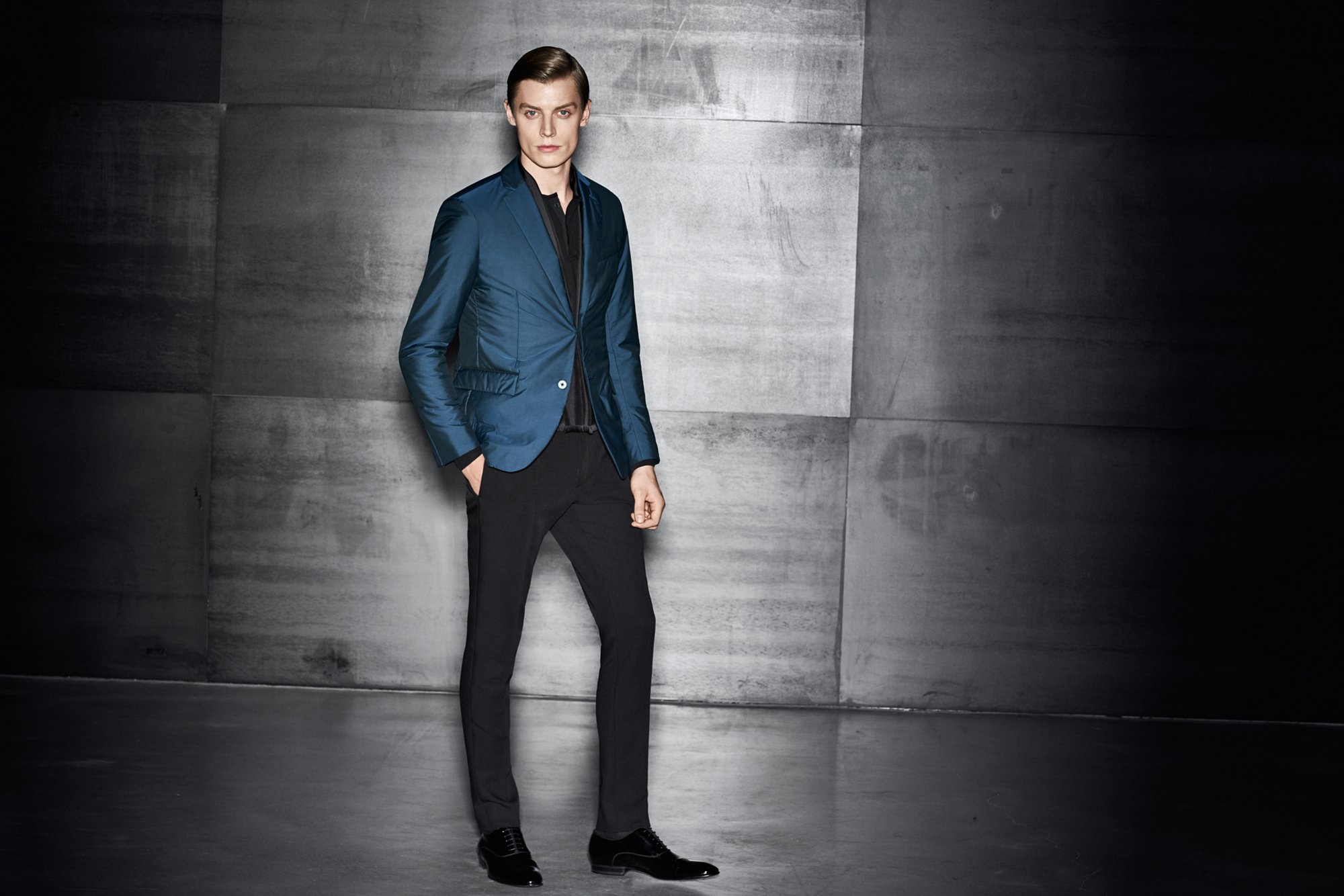 Blue jacket over black knitwear and black trousers with black shoes by BOSS